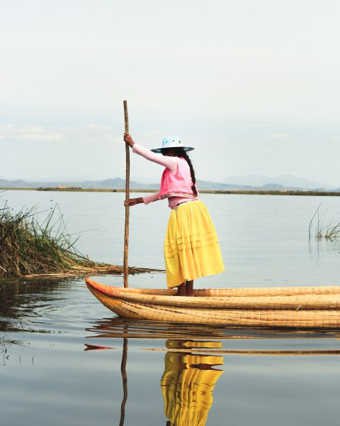 Woman in Boat in the Floating Islands, Lake Titicaca, Peru