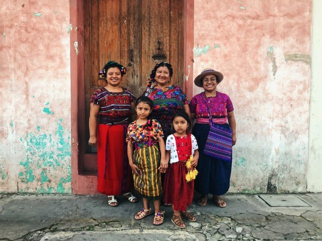 A group of Latin American women and children in traditional dress