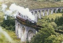 A train crosses the Glenfinnan Viaduct in Scotland.