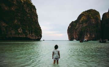 Woman looking out over Maya Bay.