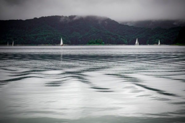 Sail boats on the rippling waters of a lake in the Masurian District, Poland