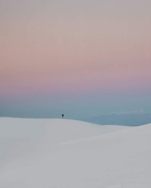 Lone figure in pastel skies of white sands national monument