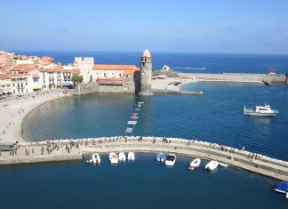 sunny harbor and beach in collioure, south of france