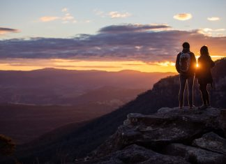 two hikers overlook mountains