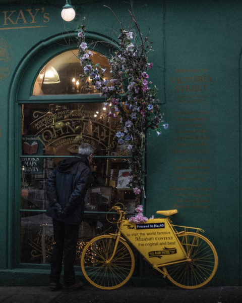 storefront with yellow bicycle