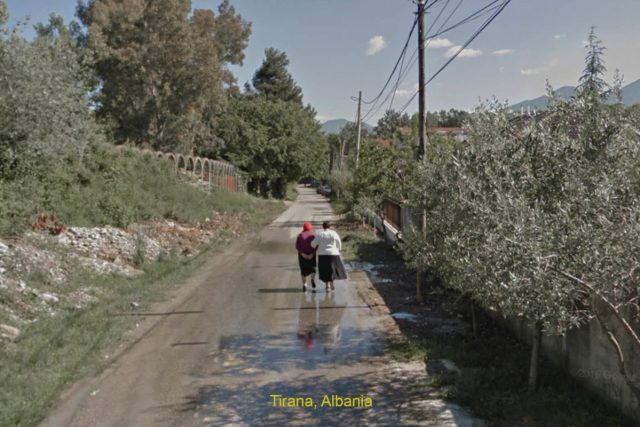 two women walking down rural road