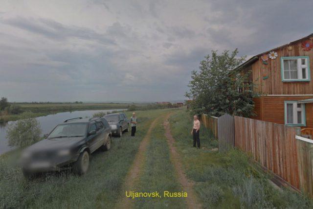 men standing in driveway