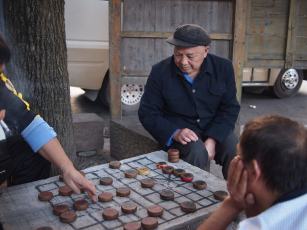 men playing chinese checkers