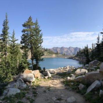 hiking trail approaching mountain lake