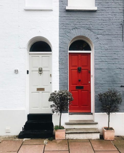 attached flats in brighton with white and red doors