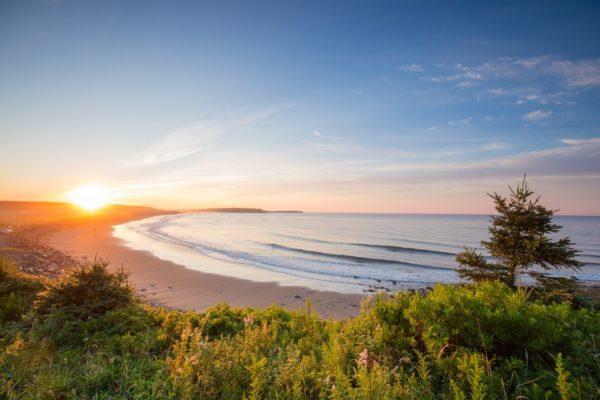 Sunset over long sandy beach in eastern shore of Nova Scotia