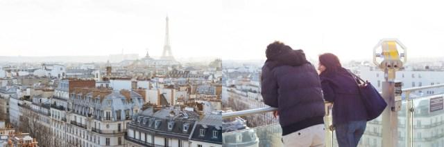 Couple overlooking city from hidden Paris view