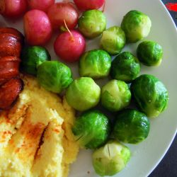 Creamy polenta with Chorizo, radishes and Brussels sprouts