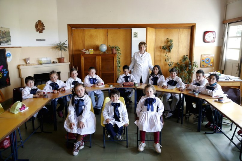 Teacher Ana Dorrego with students of the rural school Agustin Ferreira on the outskirts of Minas city, Uruguay. Andres Stapff - Reuters