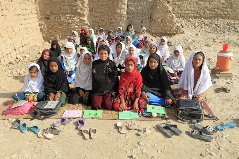 Teacher Mahajera Armani and her class of girls at their study open area outside Jalalabad city, Afghanistan. Parwiz Parwiz - Reuters