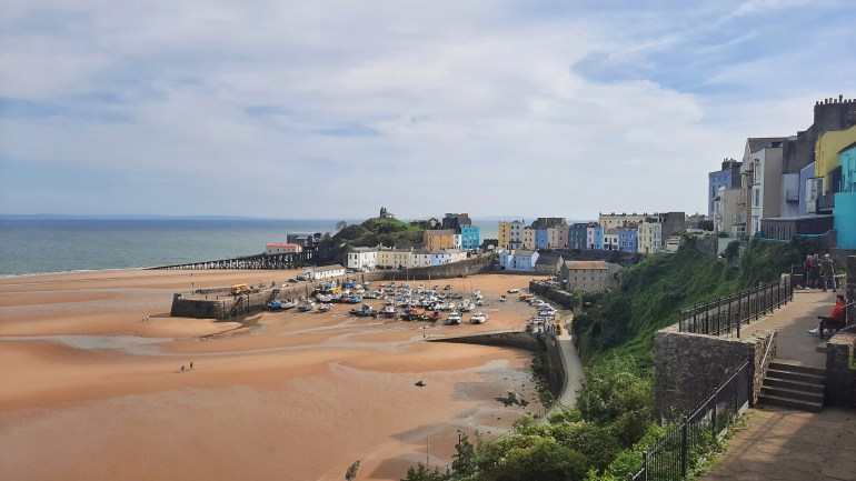 The Victorian town and harbour of Tenby, Pembrokeshire, with pastel-coloured houses surrounding Tenby Harbour and beach