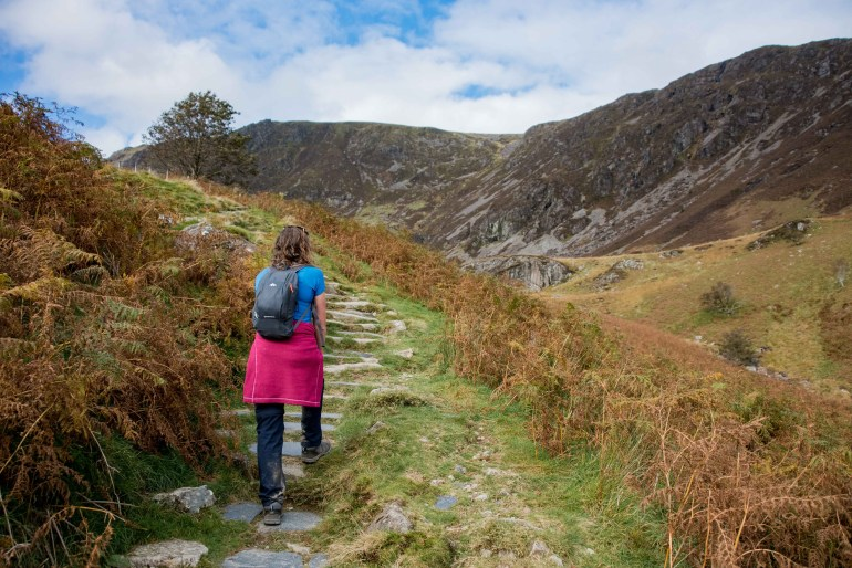 Girl hikes Minffordd Path to the summit of Cadair Idris in Snowdonia, Wales