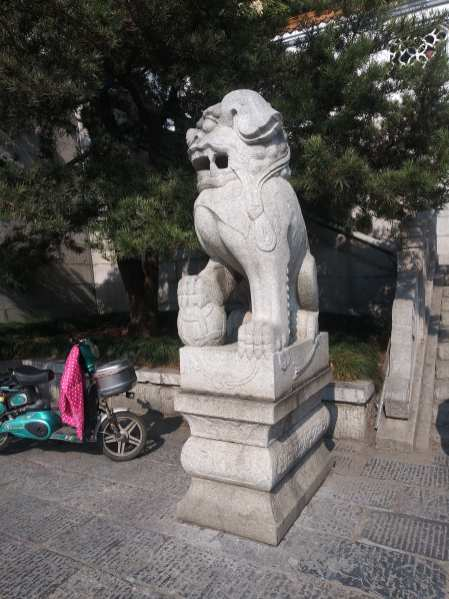 Traditional Chinese lion with ball statue photo courtesy of Hugo Morel
