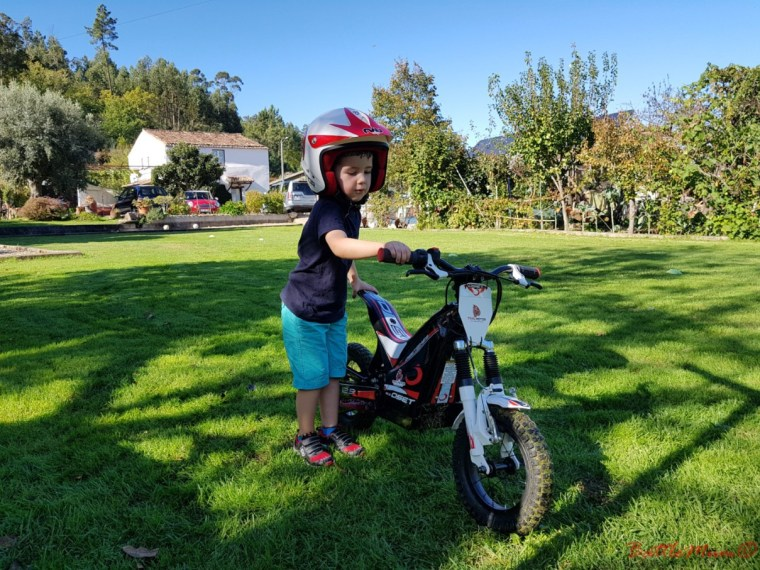 BattleKid proud as punch beside an Oset 12.5 motorbike