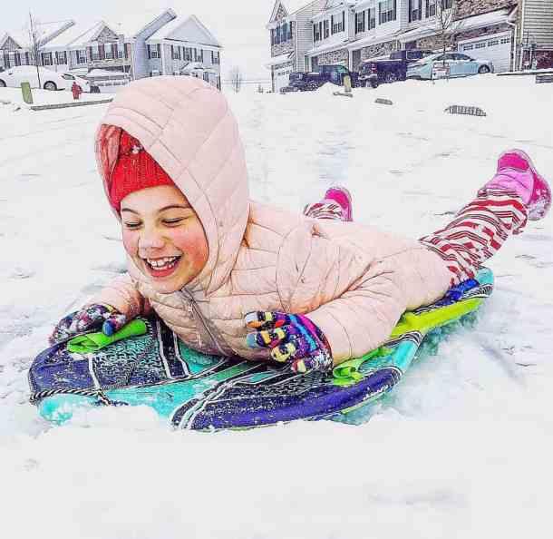 biracial children sledding