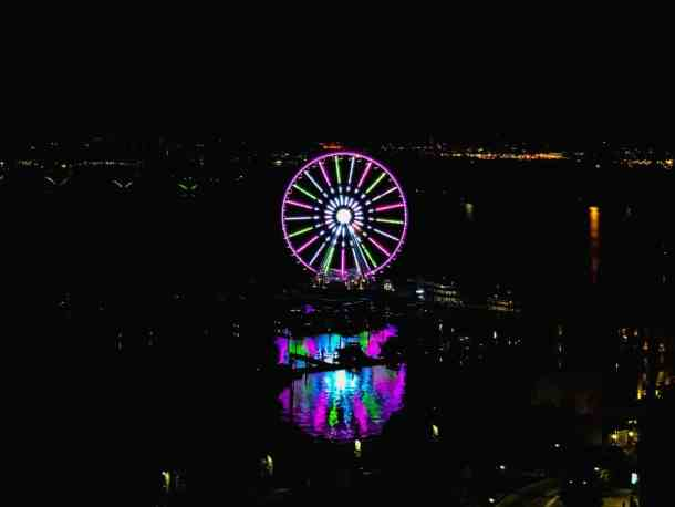 Capital Wheel at the National Harbor lit up at night