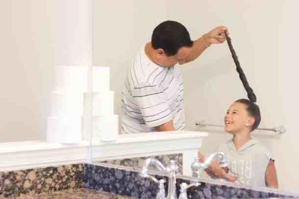 Dad doing Daughter's Hair with bathroom air freshener