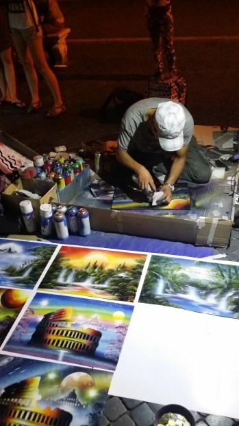 Street Artist working hard in Rome