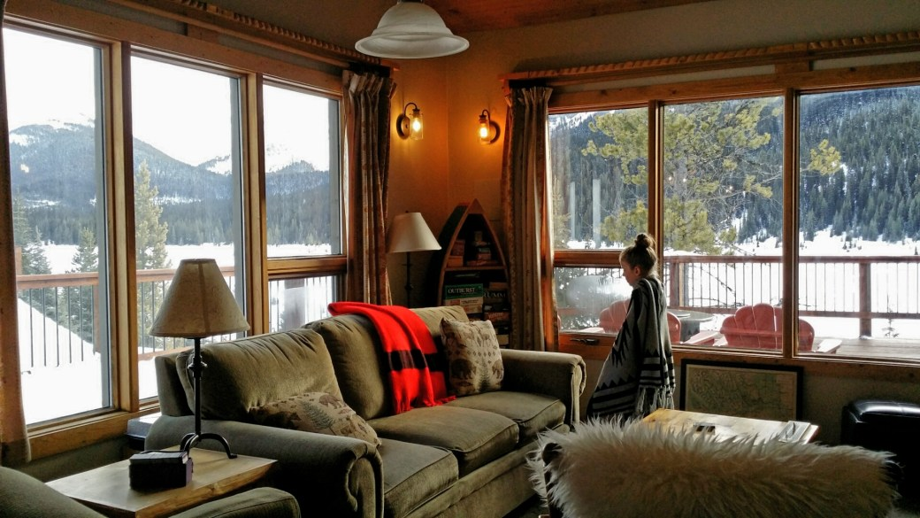 Littlest 'B' chooses a game for family evening fun in the main lodge, Kananaskis, Alberta