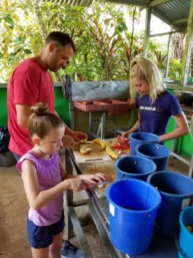 Cutting up Food for the animals at Kids Saving the Rainforest, Quepos, Costa Rica