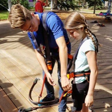 Little B gets a lesson in using her Clic-It Belay System, Snow Valley Aerial Park, Edmonton, Alberta
