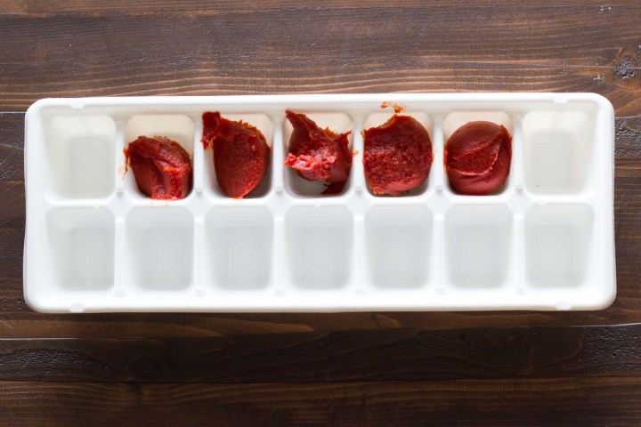 Freeze tomato paste in ice cube trays for easy access in recipes later