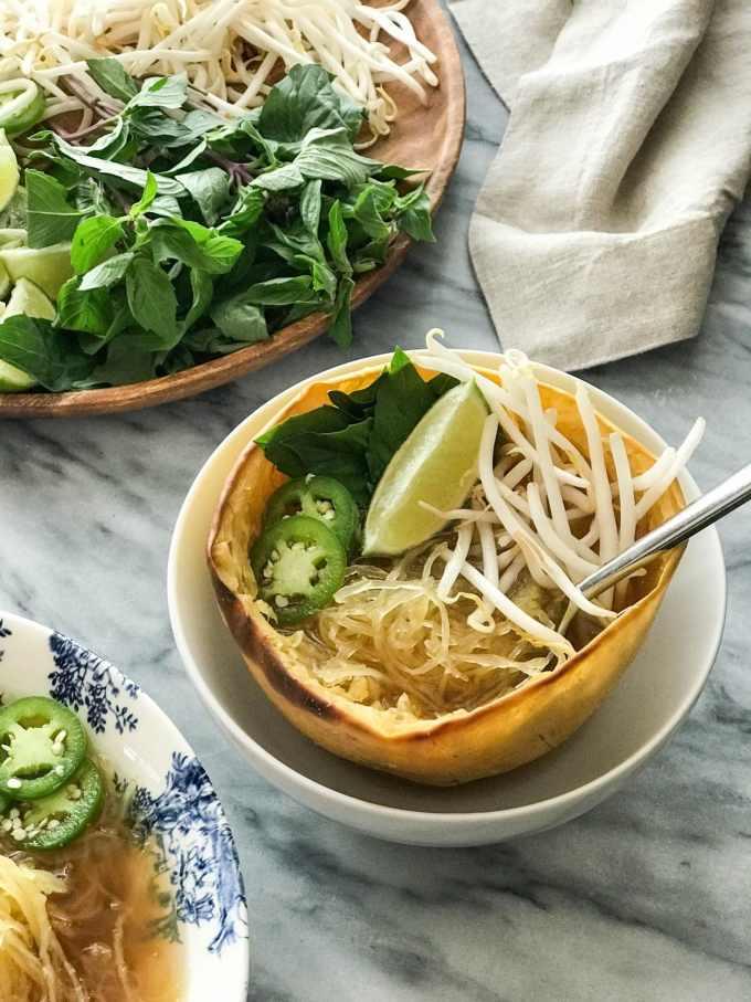 Spaghetti Squash Vegan Pho | Spaghetti squash half used as bowl | https://passtheplants.com/