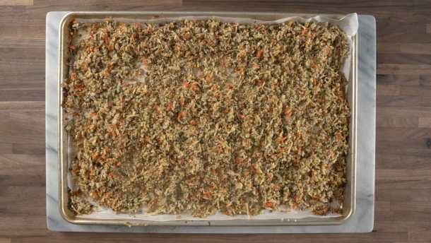 Overhead image of vegan ground beef on a baking sheet after being roasted in the oven.