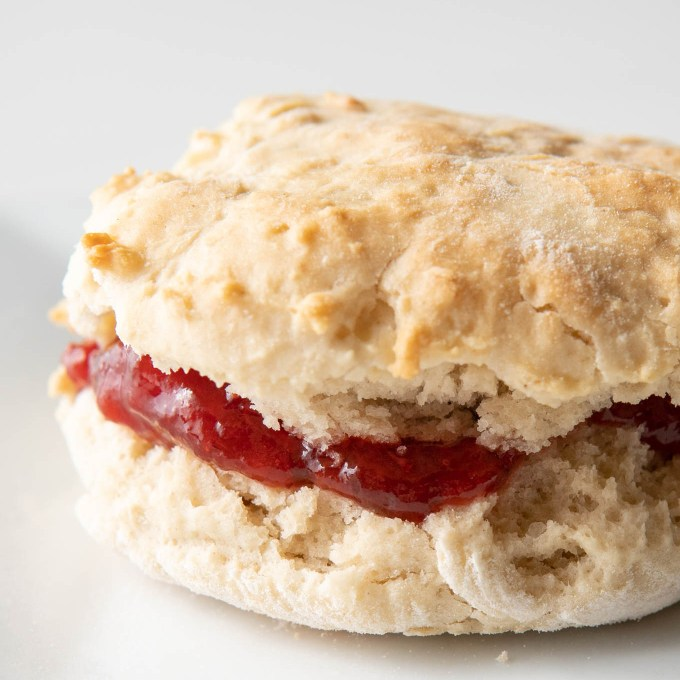 close up of oil-free vegan biscuit stuffed with strawberry jame