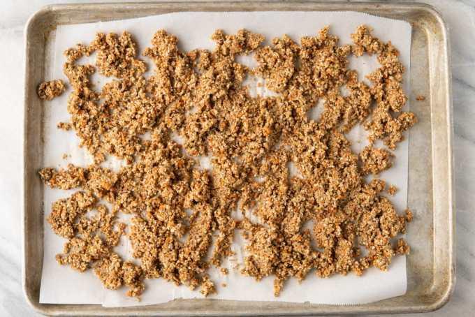 uncooked vegan sausage crumbles on a baking sheet
