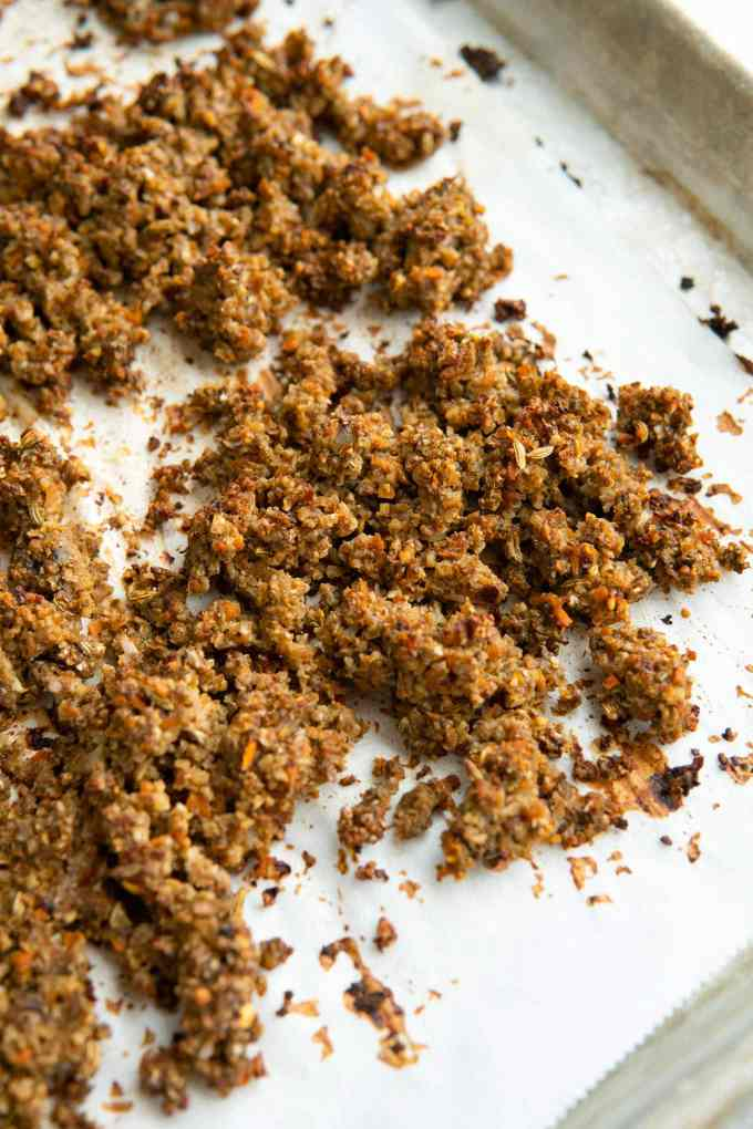 vegan sausage crumbles on a baking sheet after roasting