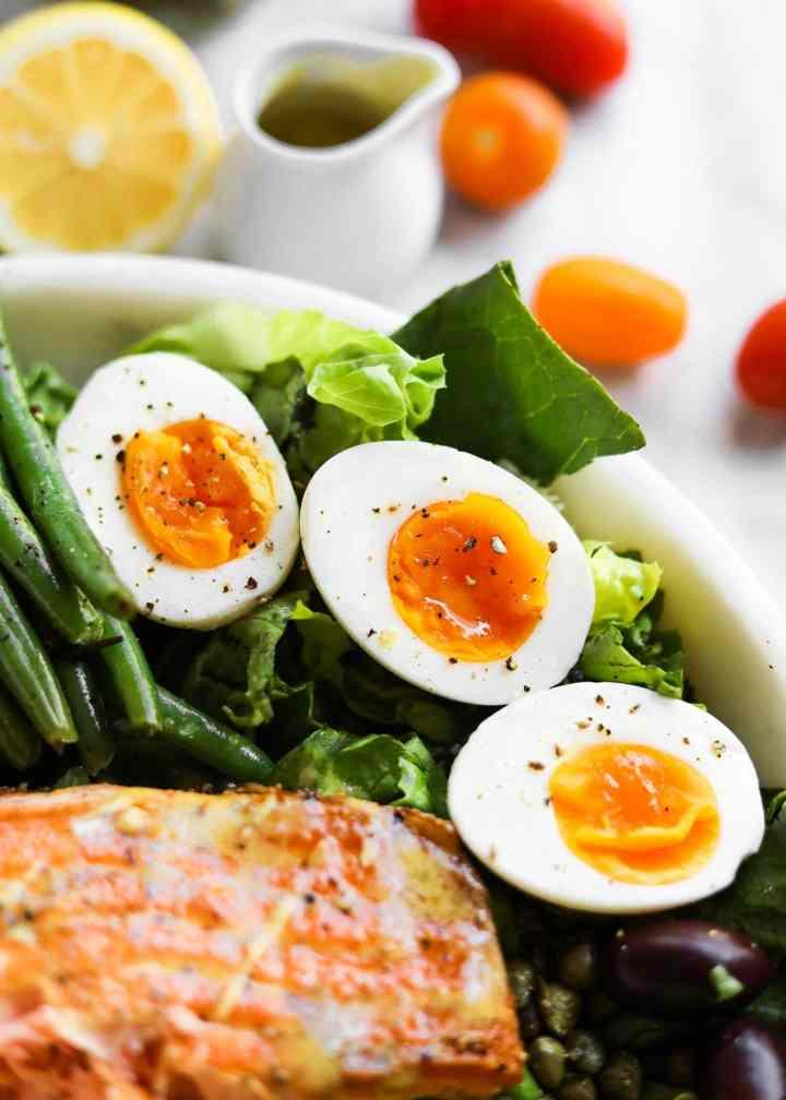 jammy soft boiled eggs on salad
