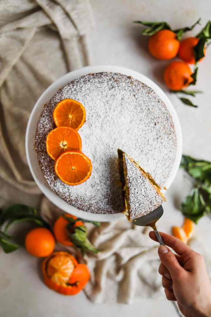 Clementine Olive Oil Cake with sliced citrus and cake server