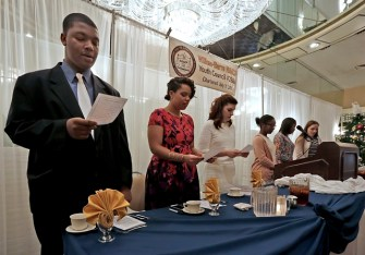 Wilkes-Barre NAACP Youth Council #28AM officers and executive committee members sing 'Lift Every Voice & Sing' at an inaugural luncheon Sunday afternoon in Wilkes-Barre. From left: Treasurer David Barber, First Vice President Sabrina Robertson, Wilkes-Barre City Councilwoman and keynote speaker Beth Gilbert, Assistant Secretary Moriah Adeghe, President Emily Laurore, and executive committee member Avery Cunningham