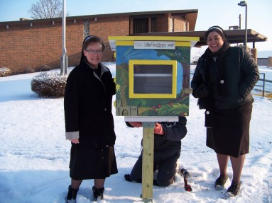 Franciscan Sister Pamela Biehl and Sister Regina Rose Pearson and Little Free Library
