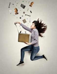 Woman is running with a box in her hands, and some things are coming out of it.