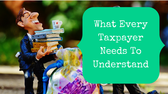 picture of a guy with an I heart tax mug and blog post title, what every taxpayer needs to understand