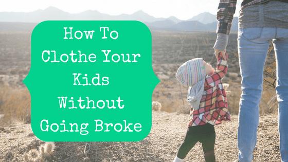 Picture of toddler holding parents' hand with blog post title How To Clothe Your Kids Without Going Broke