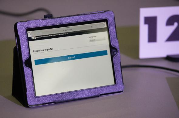 A tablet computer displaying the electronic queue portal for delegates