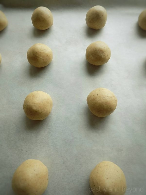 Steps of making Easy Cinnamon Cookies: Rolling the dough into balls