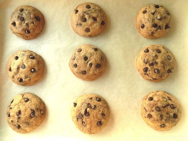 Soft and Chewy Chocolate Chip Cookies on a baking sheet after baked.