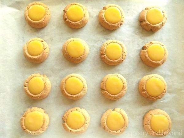 Ginger and cinnamon thumbprint cookies filled with lemon curd.