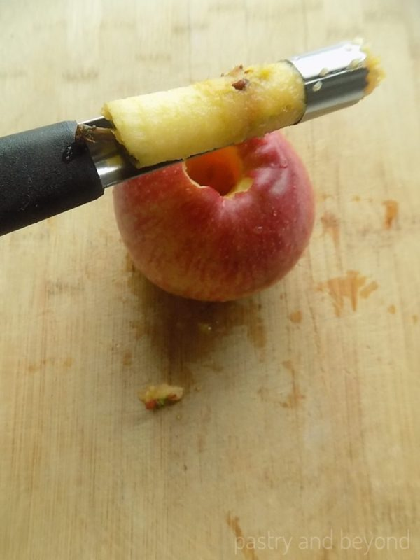 Cored apple with an apple corer
