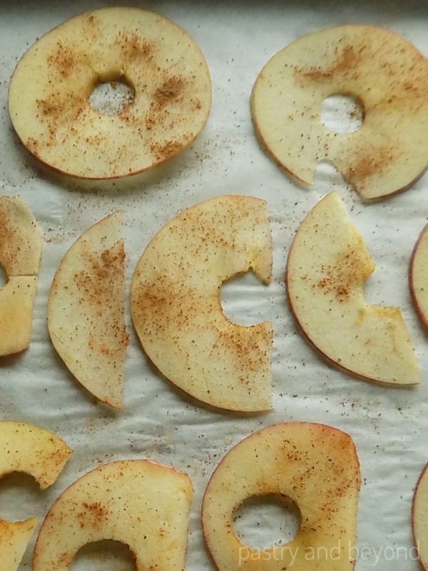 Thinly sliced apples with cinnamon on top