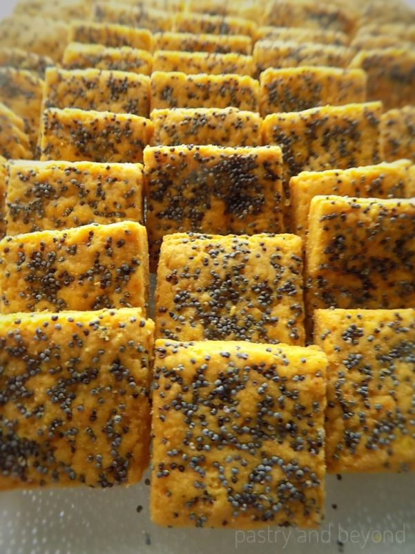 Savory Curry Cookies with Poppy Seeds in a row.